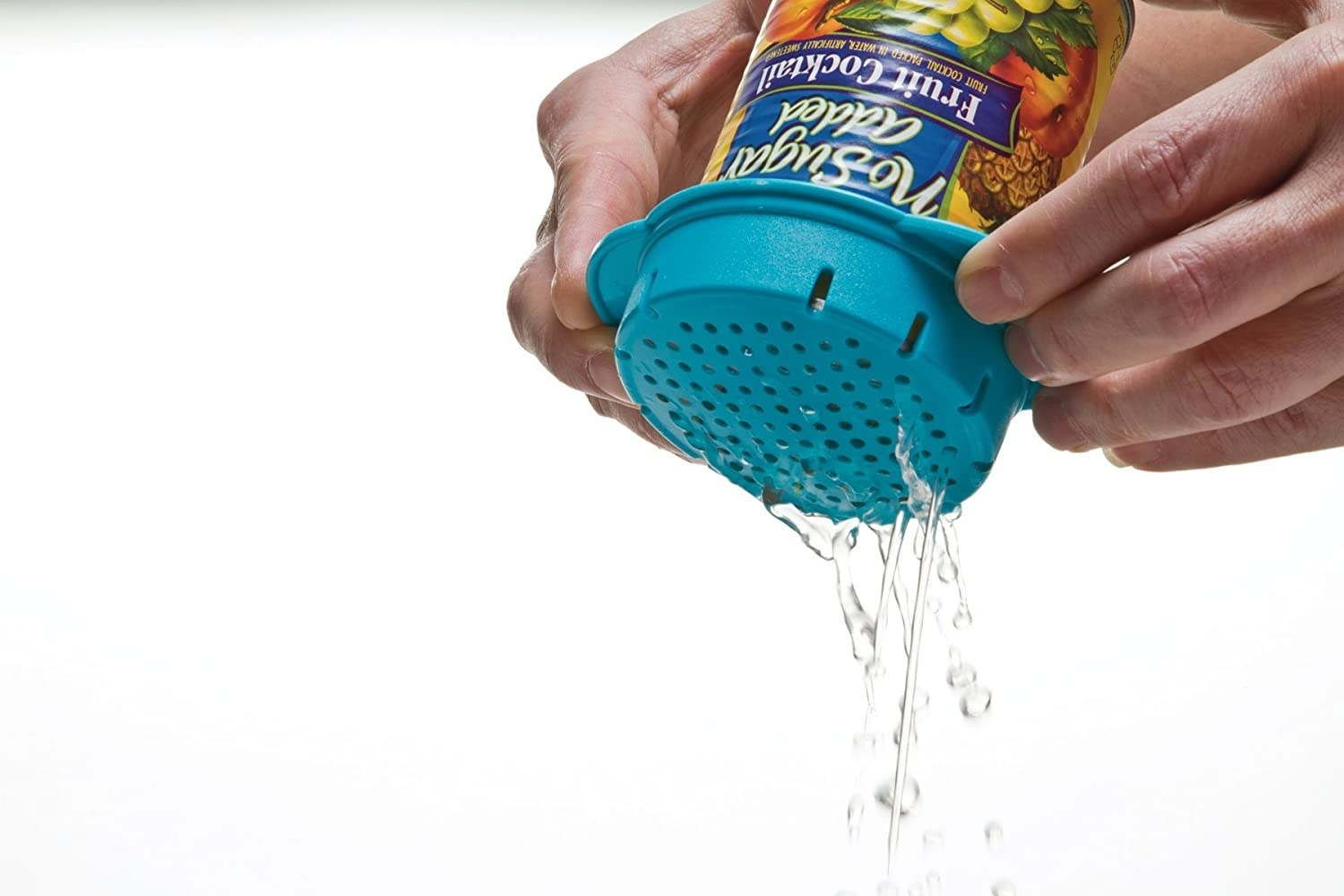 person draining water from can using colander