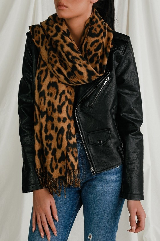 model wearing fringed scarf with large print