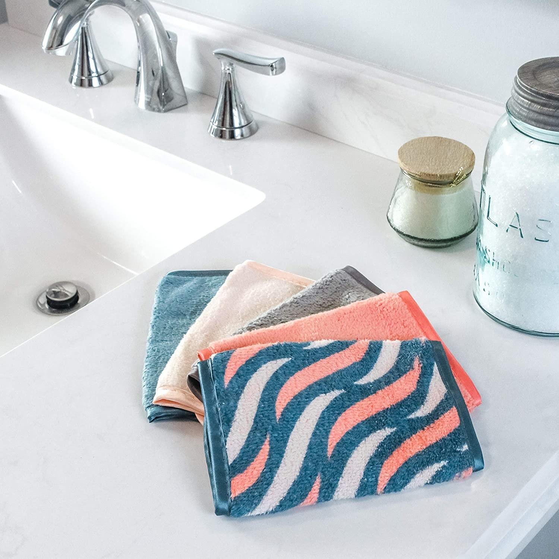four cloths on a bathroom sink