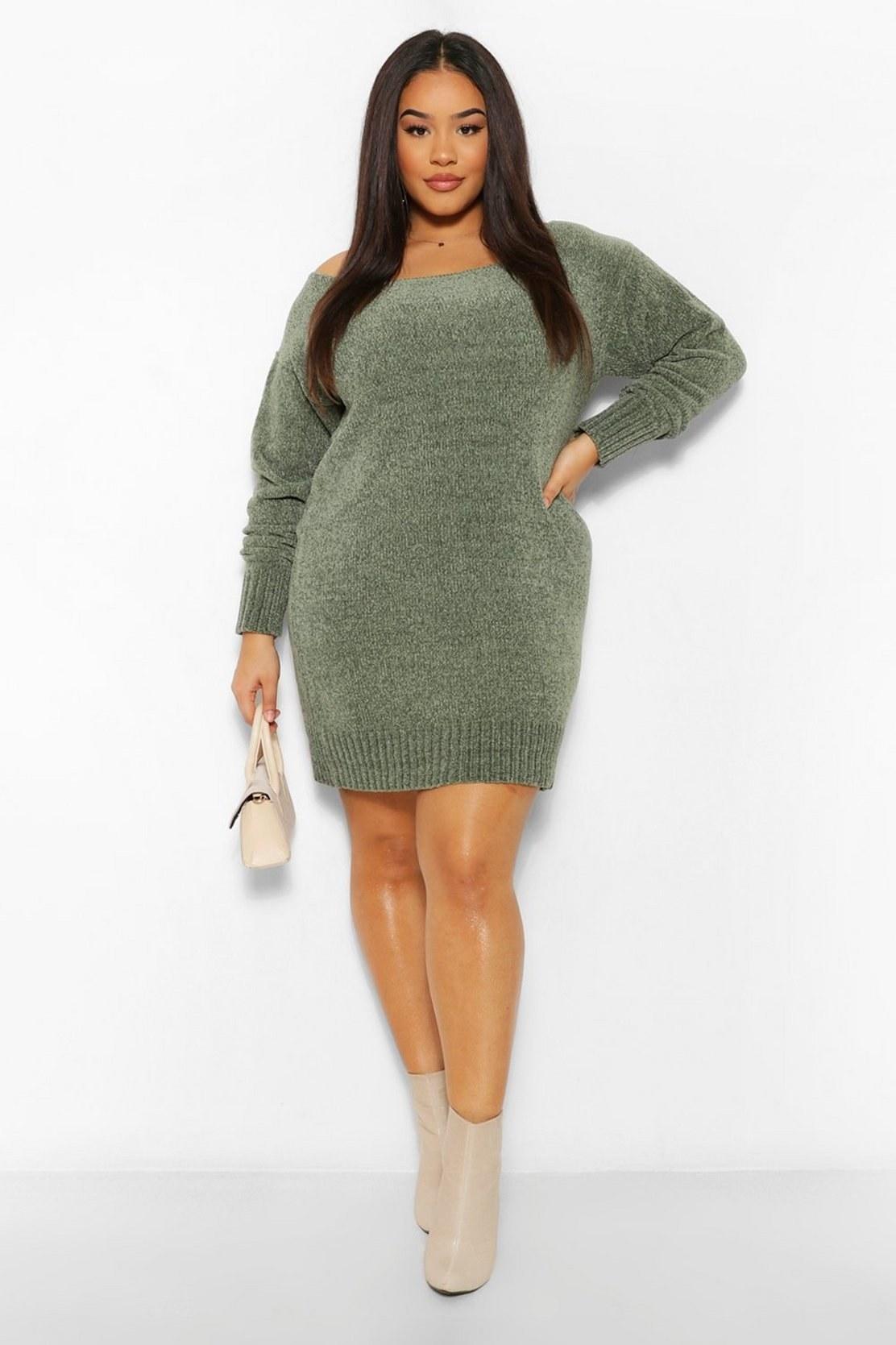 Model in the sage green mini dress