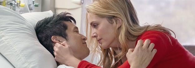 Jenn comforting Sol in his hospital bed