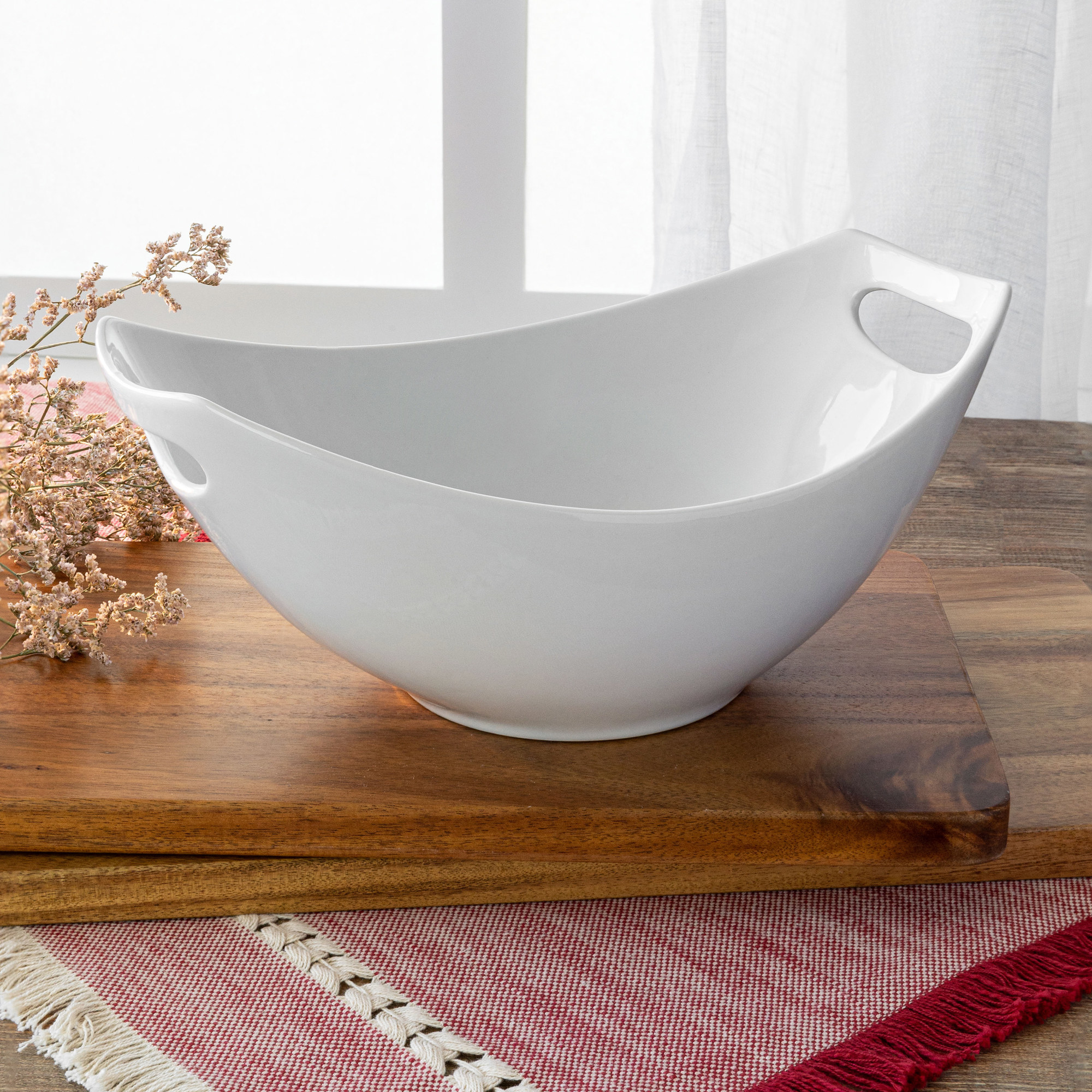 The white porcelain large bowl on a wood tray