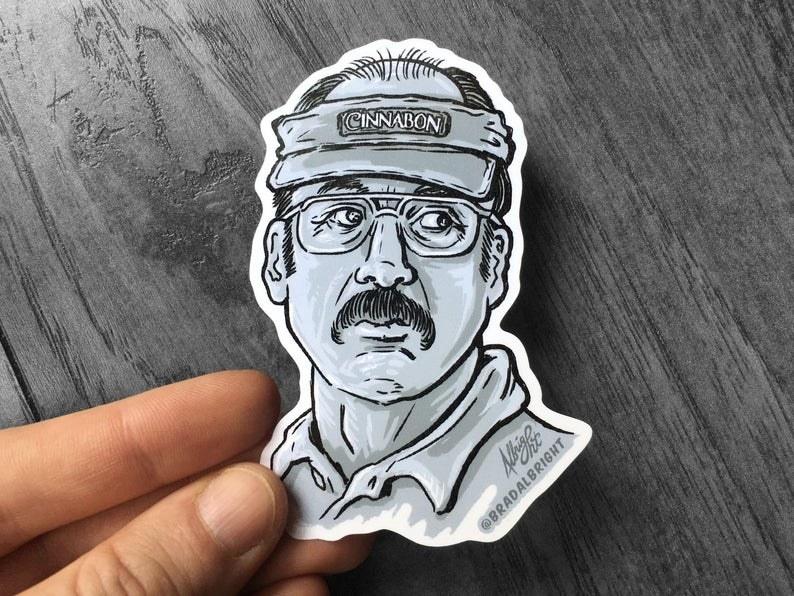 A hand drawn and cut sticker of Gene/Saul wearing a Cinnabon visor from Better Call Saul