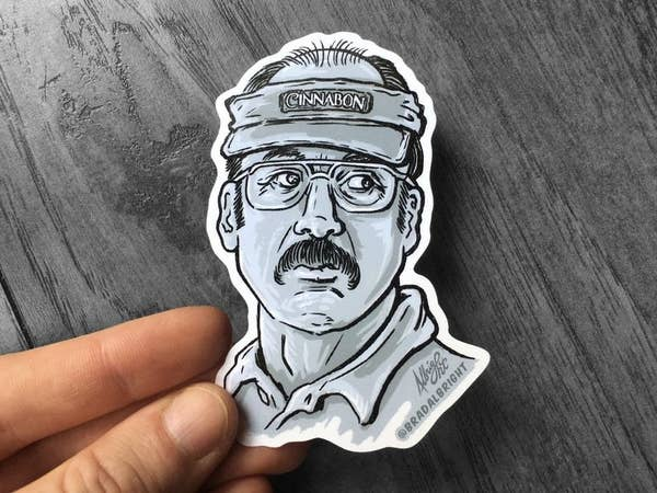 A hand drawn and cut sticker of Gene/Saul wearing a Cinnabon visor from Better Call Saul