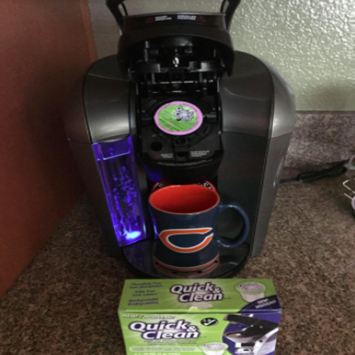 K-cup machine with the cleaning pod in it