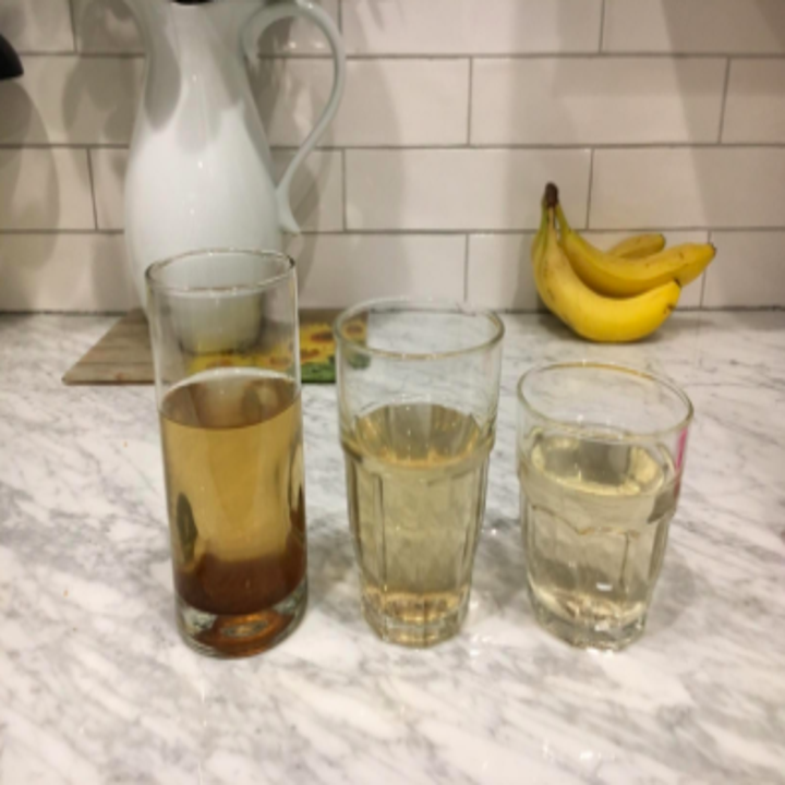 reviewer pic of three glasses of dirty water, then slightly clearer water, then almost completely clear