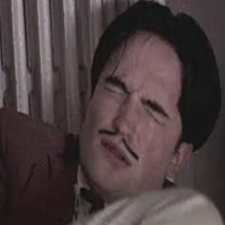 Pattinson as Dali masturbates with eyes shut tightly