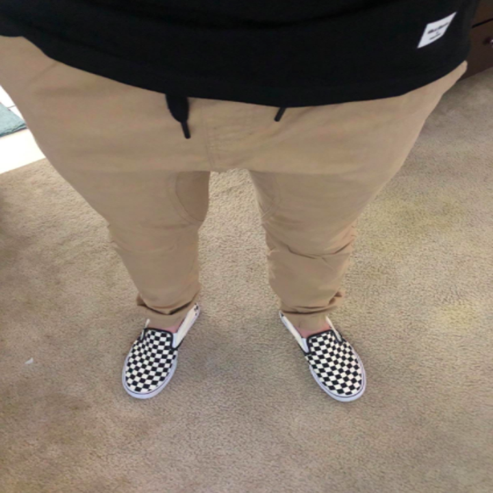 a reviewer's photo of the pants in tan