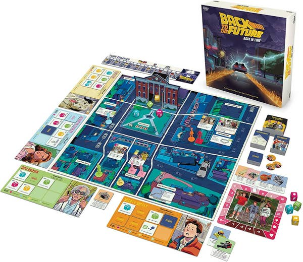A game board featuring cartoon drawings of the Hill Valley town square, Marty McFly, Doc Brown, as well as game pieces like the DeLorean time machine and dice
