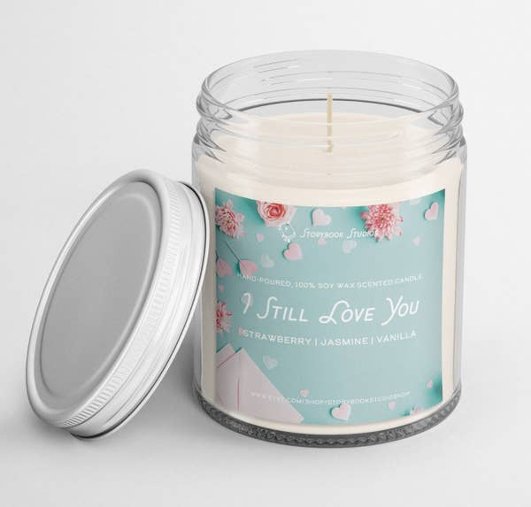 A jar candle with lid and a label that says I still Love You
