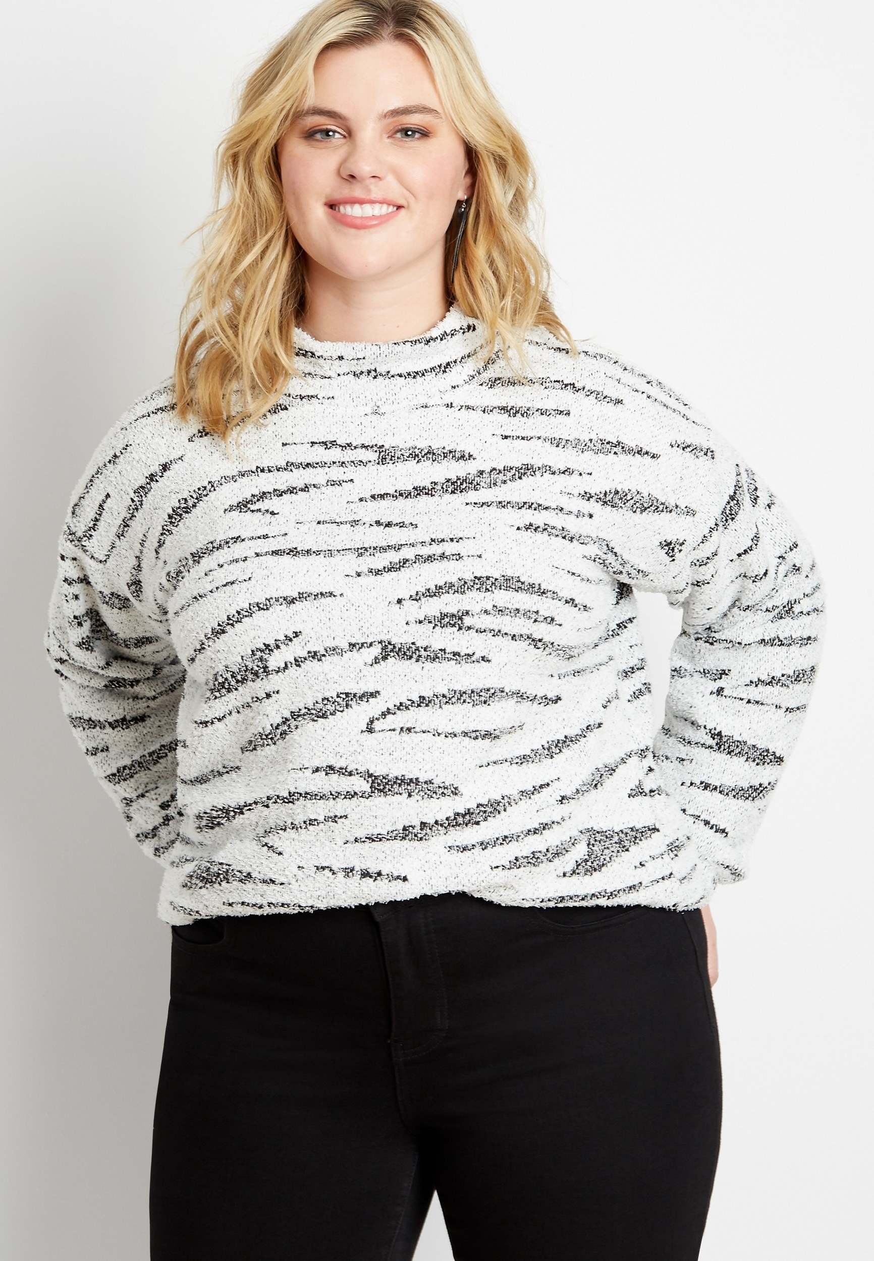 A model in the mock neck top