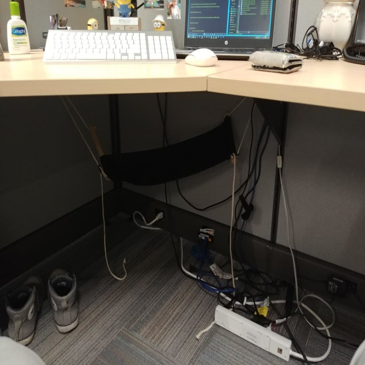 reviewer image of the foot hammock hanging under an office desk