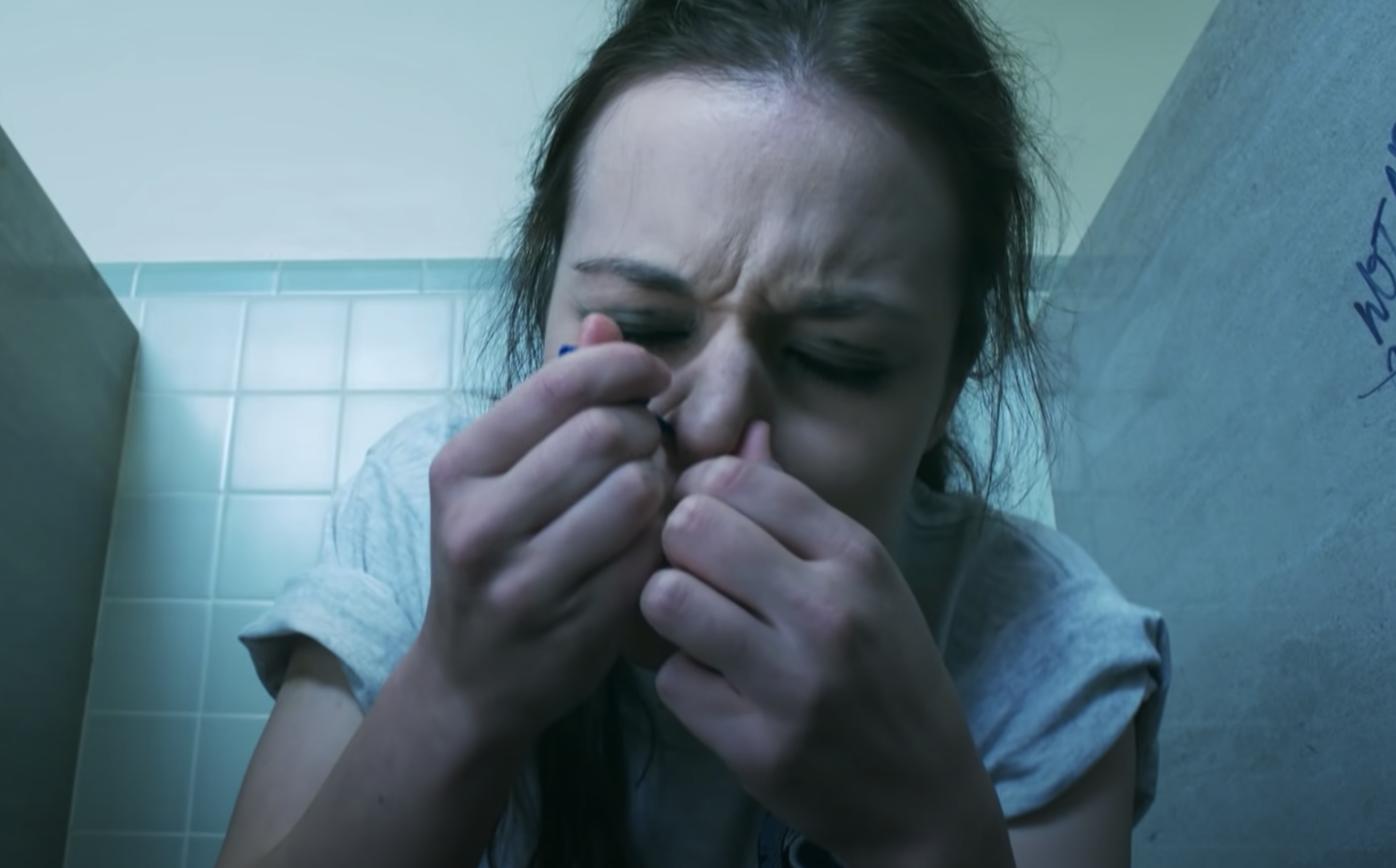 teenager snorting cocaine in school bathroom