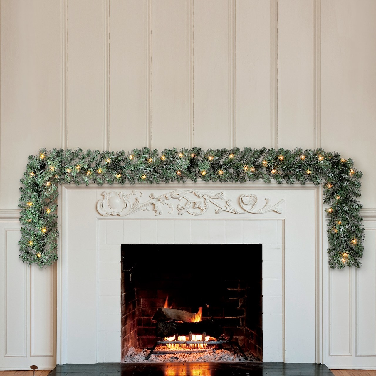 The garland decorating a mantle above a fireplace