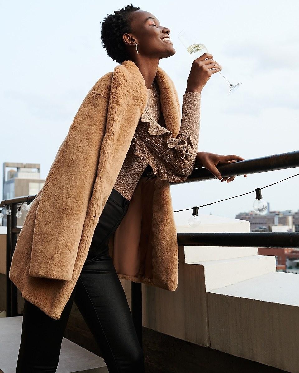 Model in the camel coat