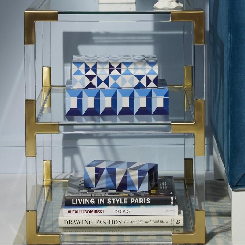 The box on the bottom shelf