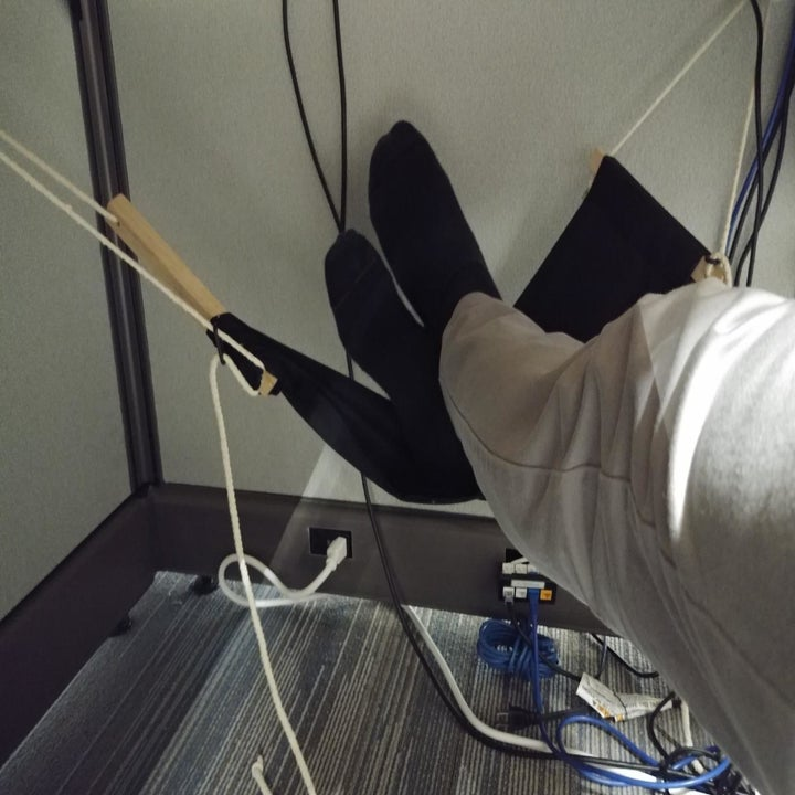 reviewer image of their feet resting in the same foot hammock