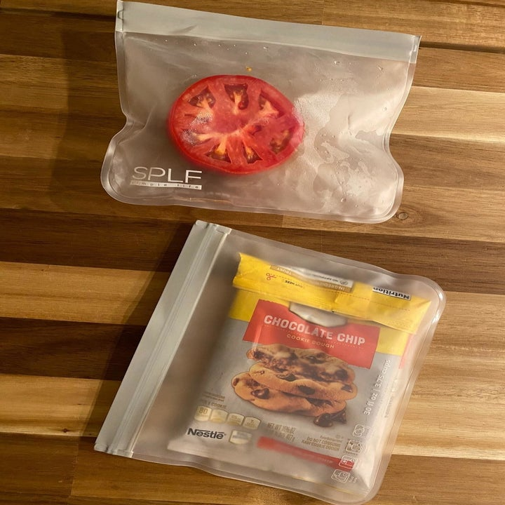 A reviewer's photo of two bags holding half a tomato and a bag of open cookie dough