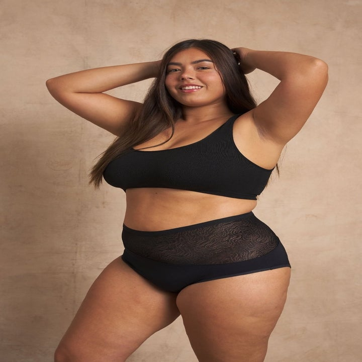 plus size model in black lacy high waisted underwear