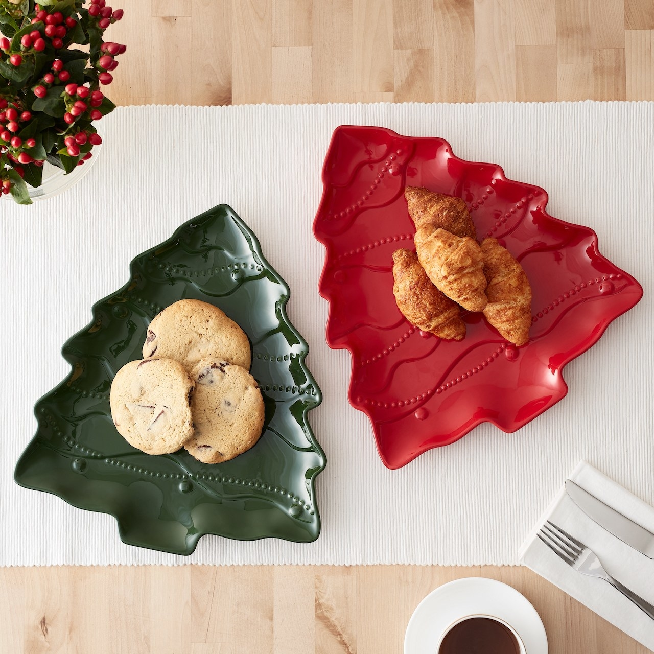 The plates with holiday cookies and treats on them