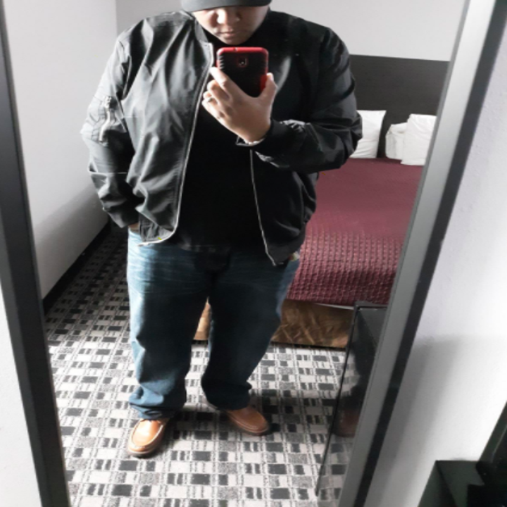 a reviewer wearing the jacket in black