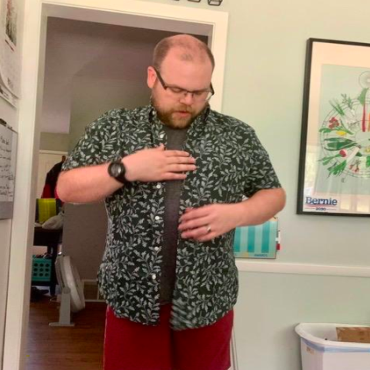 a reviewer wearing the shirt in vintage ivy print