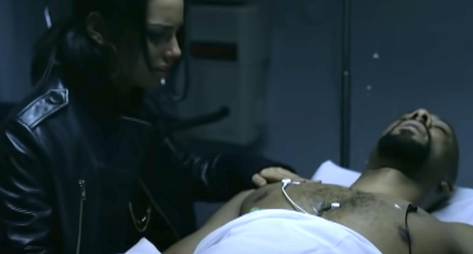girlfriend over her boyfriend's body in the hospital