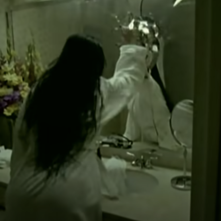 Amy Lee punching a mirror