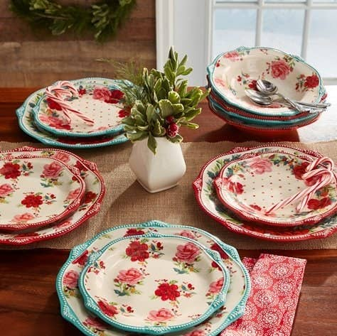 The red and blue floral-print dinnerware set for four