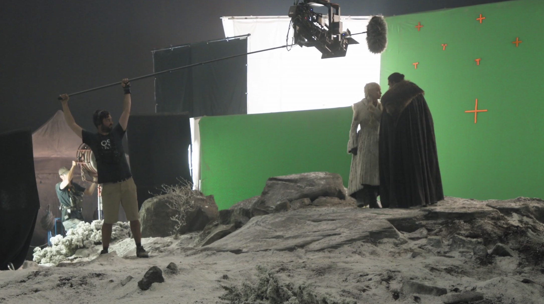 Emilia Clarke and Kit Harington filming a scene of Game of Thrones