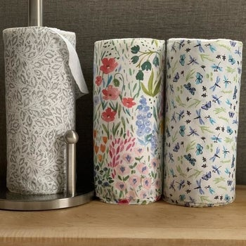 Three rolls of reusable towels in flower garden, soft gray vine, and butterfly dragonfly