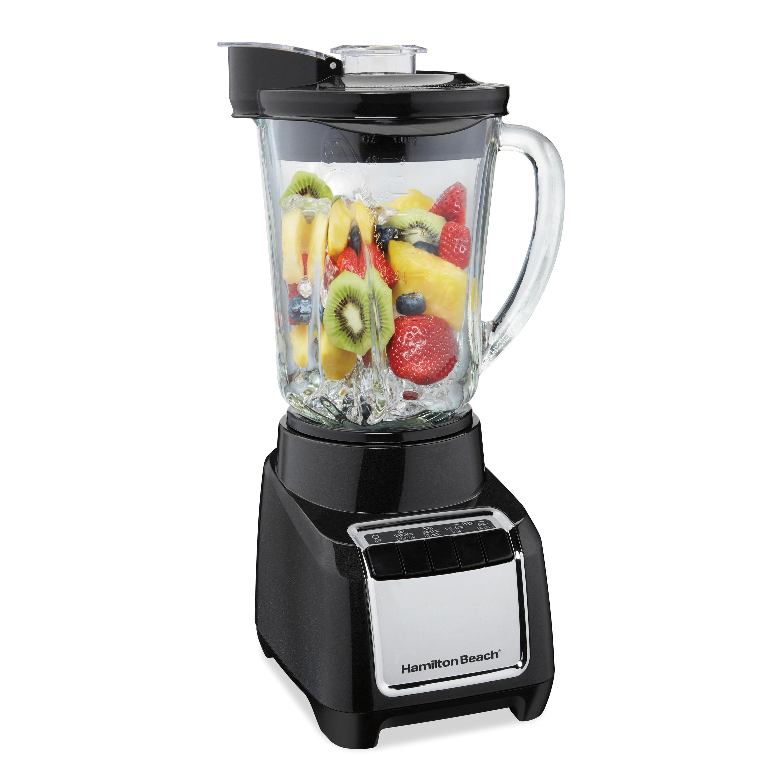 The blender full of ice and fruit