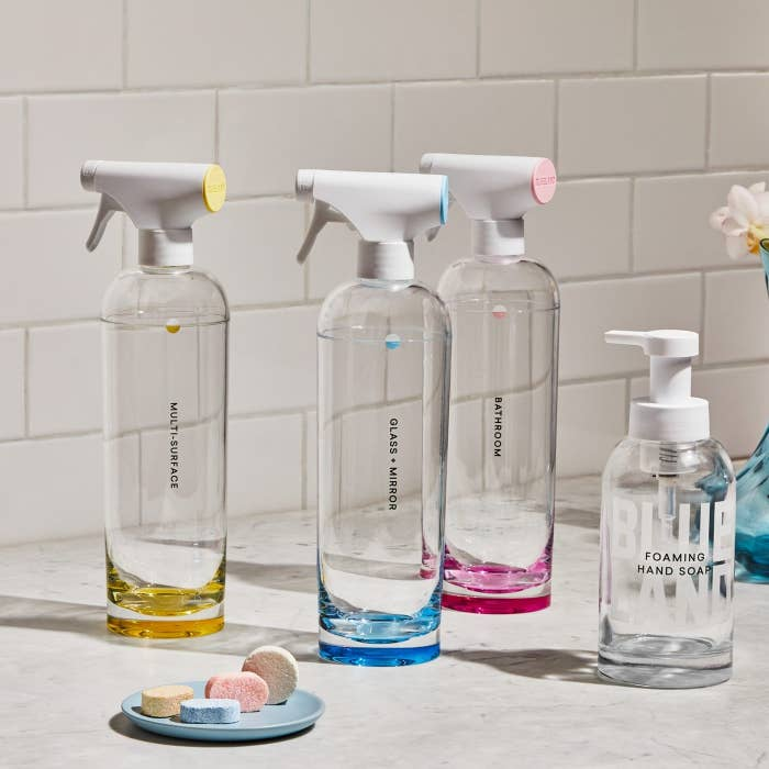 The Clean Essentials kit which comes with three spray bottles, one hand soap pump, and four cleaning tablets