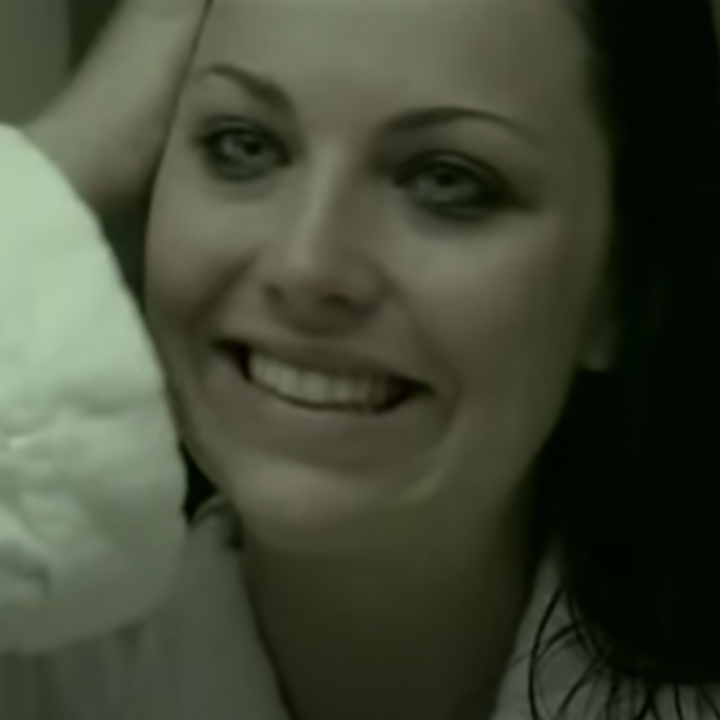 Amy Lee trying to smile in the mirror