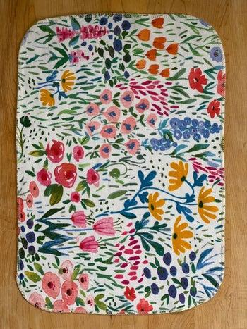 A close up of one sheet of flower garden cloth