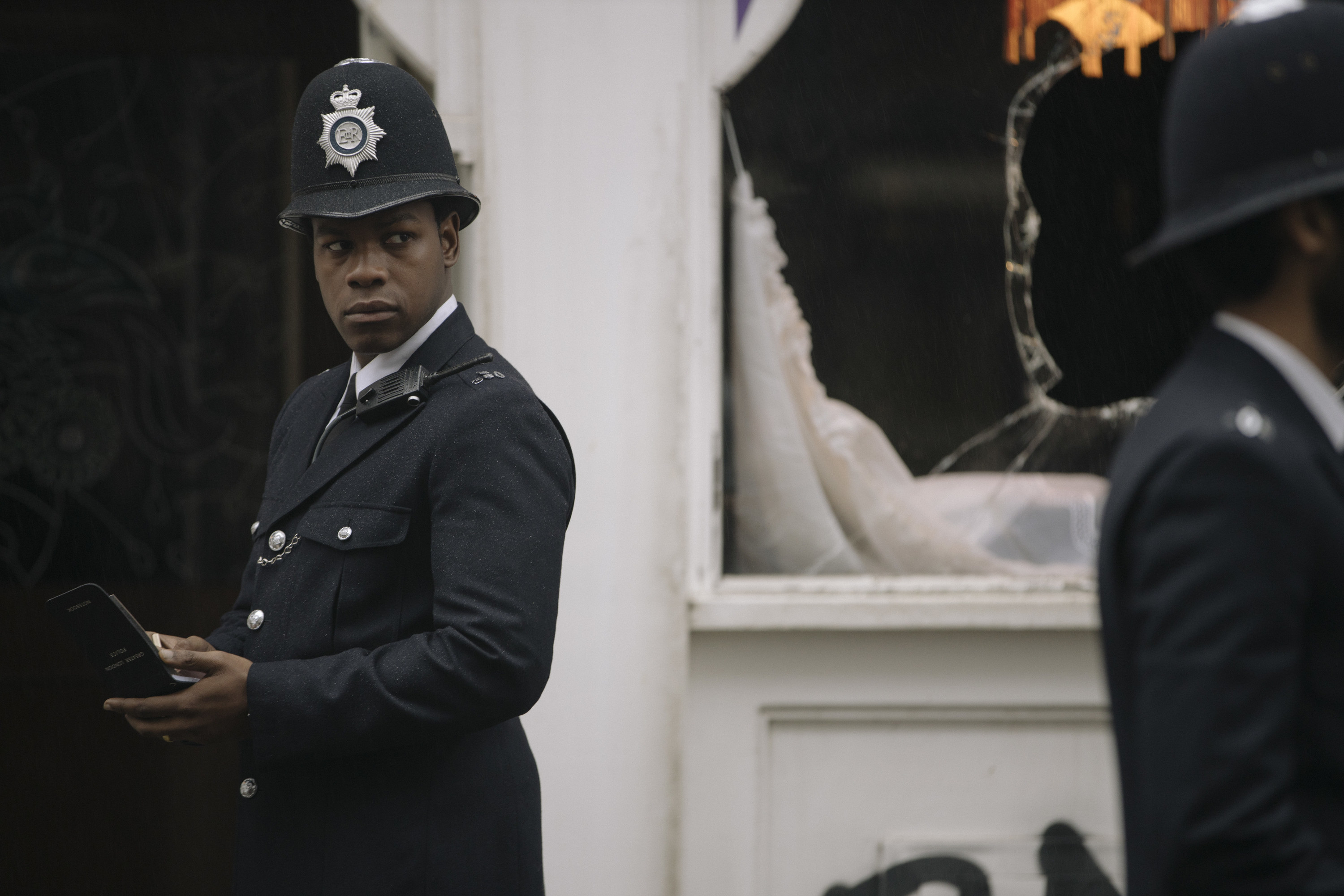 """John Boyega dressed in a cop uniform in a scene from """"Red, White and Blue"""""""