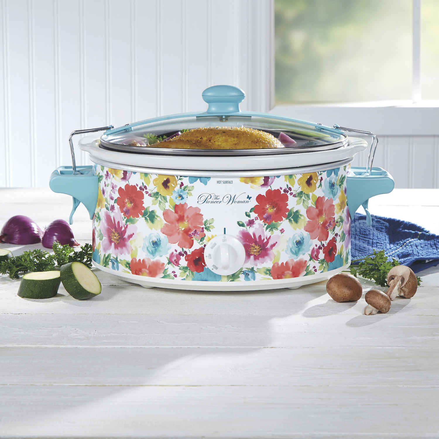 The floral slow cooker on a counter