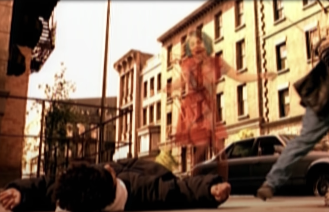 a ghost woman runs screaming to her son, who has been shot and is on the ground