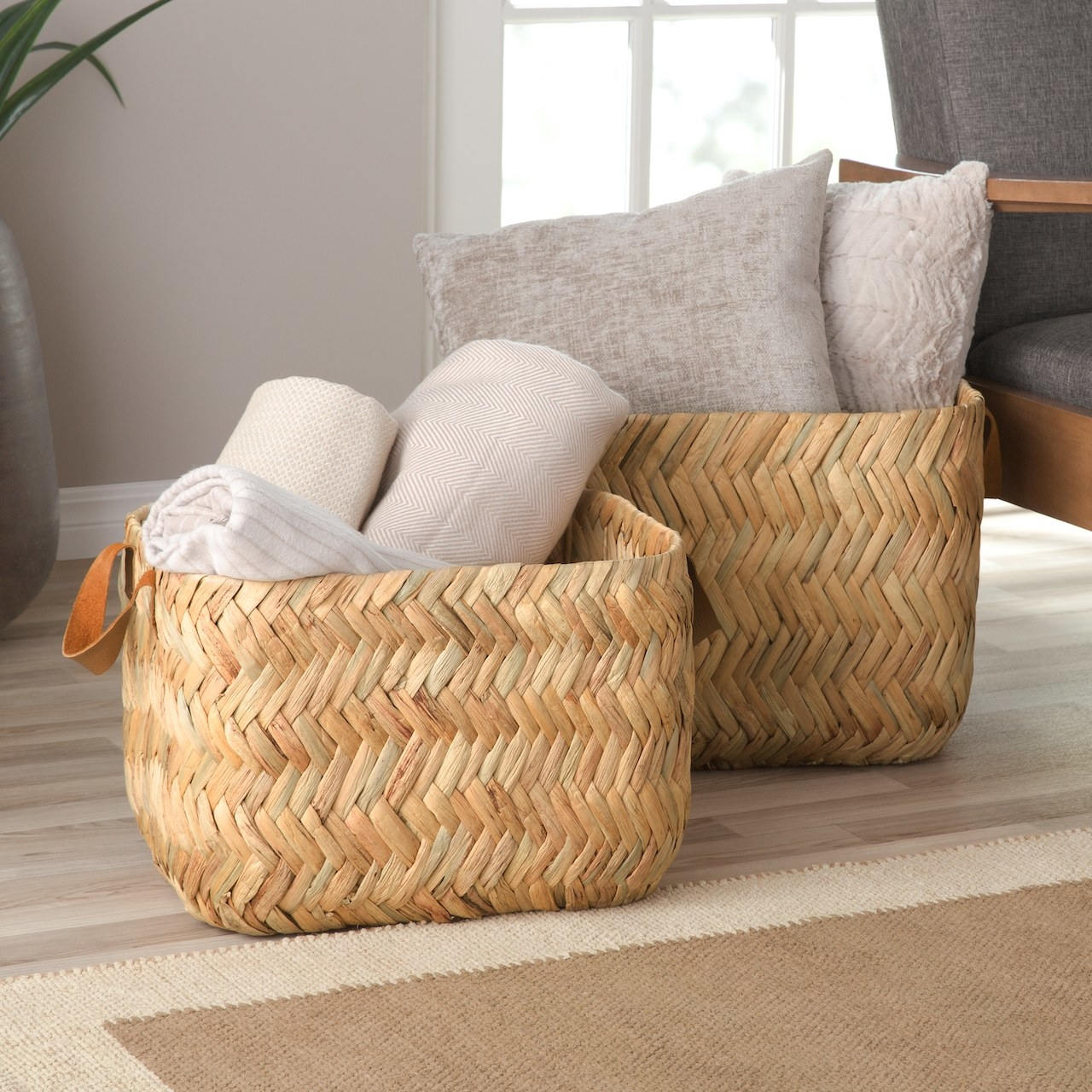 The baskets filled with pillows and blankets