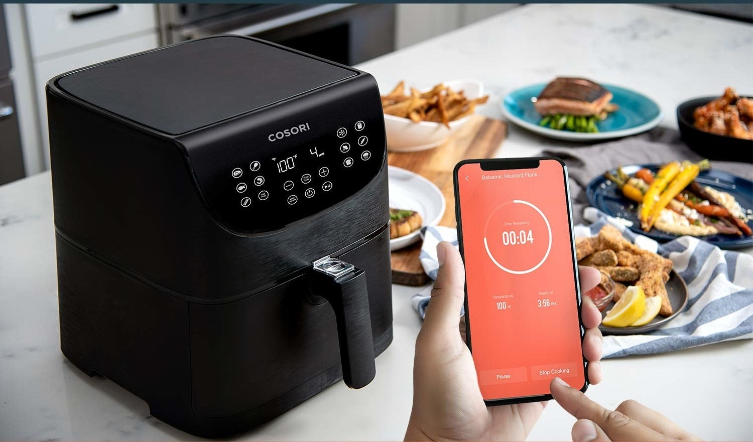 Model using smartphone app connected to Cosori air fryer