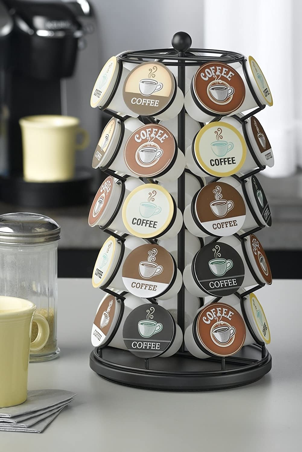 A black carousel holder that's five K-cups high on a counter