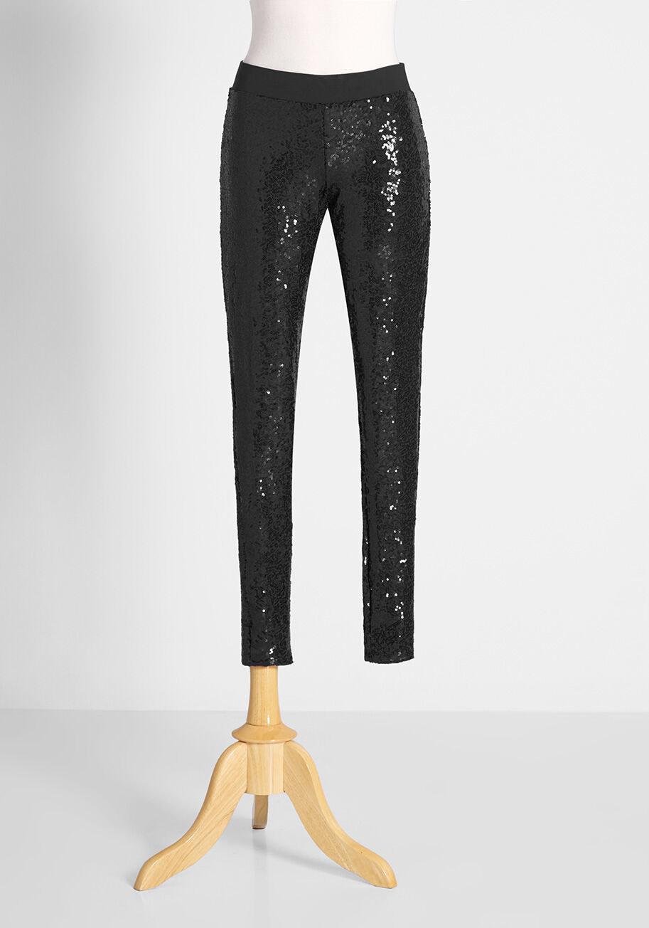The black sequin leggings on a mannequin