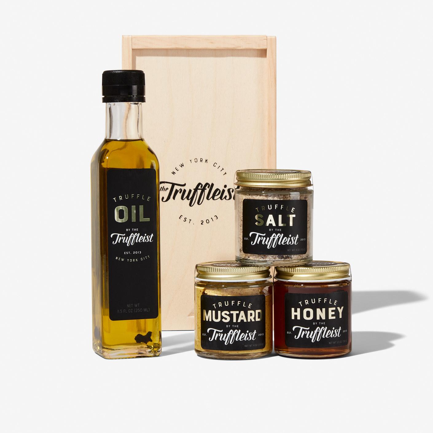 Bottles of truffle oil, truffle mustard, truffle salt and truffle honey