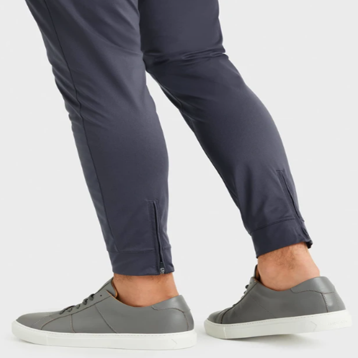 A close-up of the grey Commuter Jogger pants on someone's legs