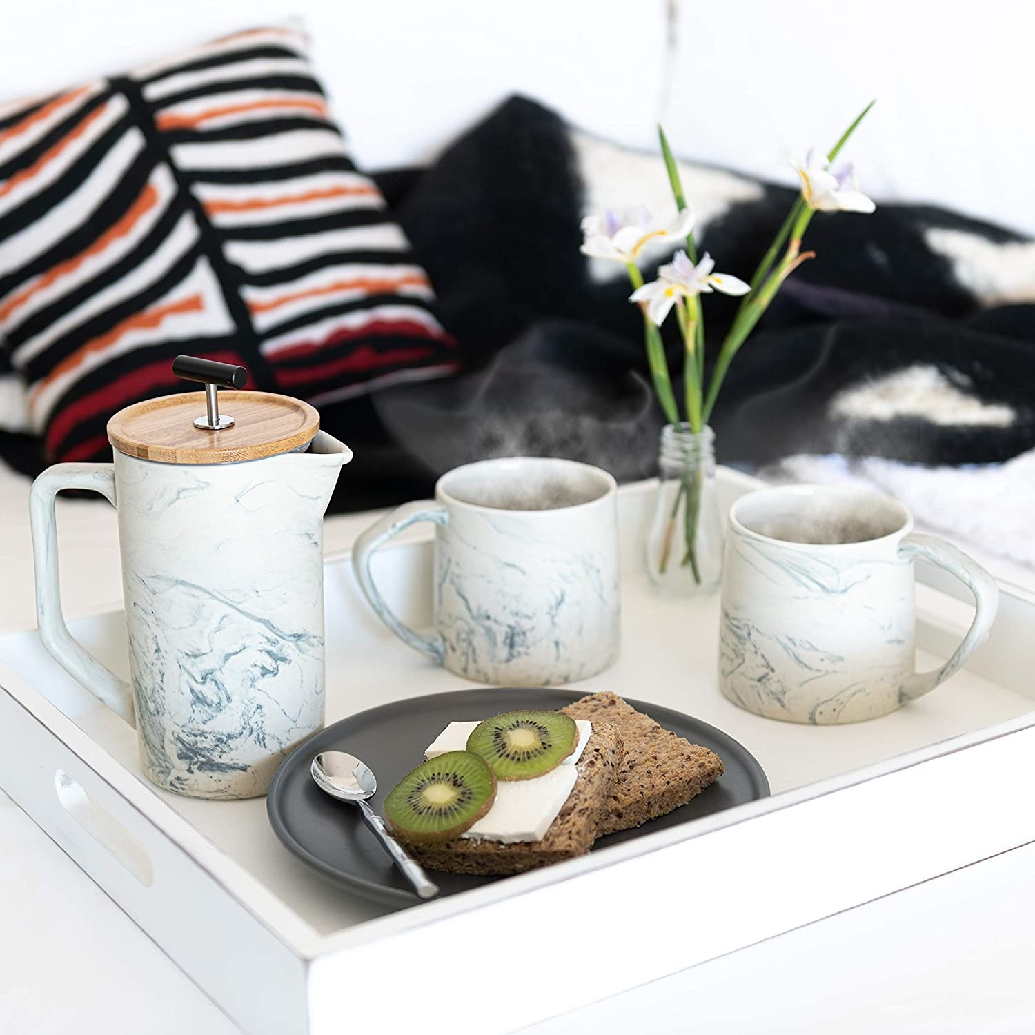 Marble-style ceramic French press on serving tray with two matching coffee cups