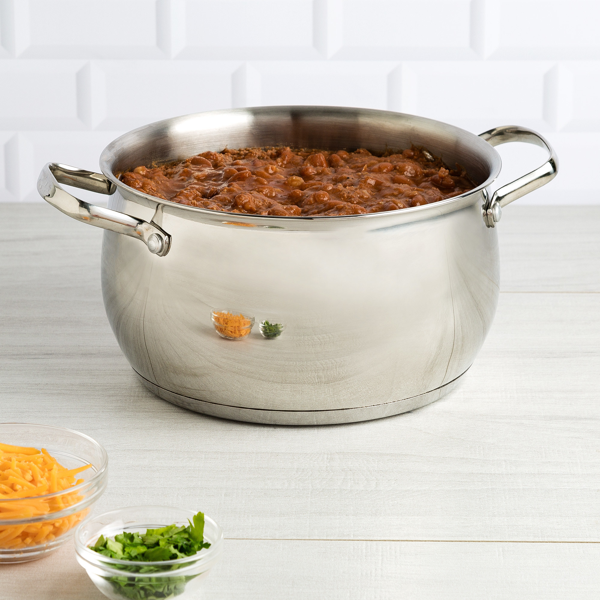 The silver colored Dutch oven, shown filled with beans