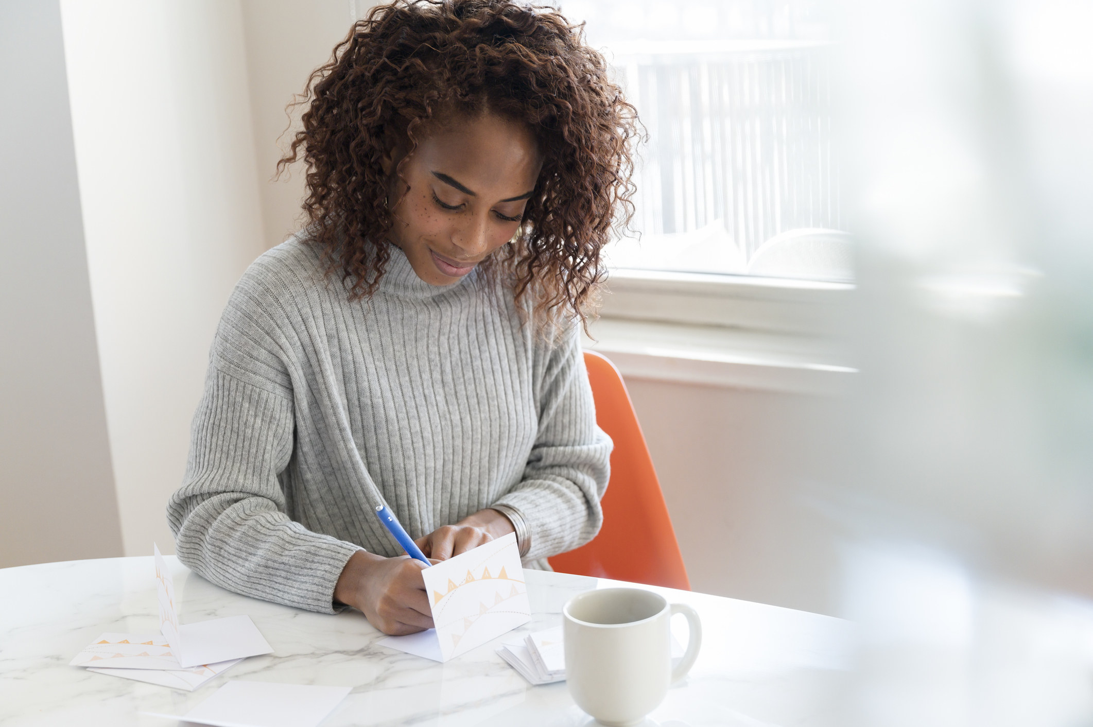 Woman writing a greeting card