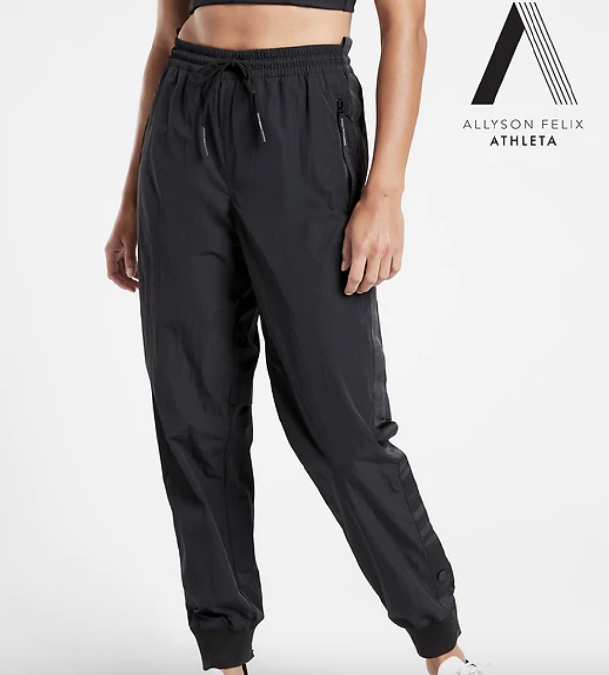 close up of a model wearing the legend track pants