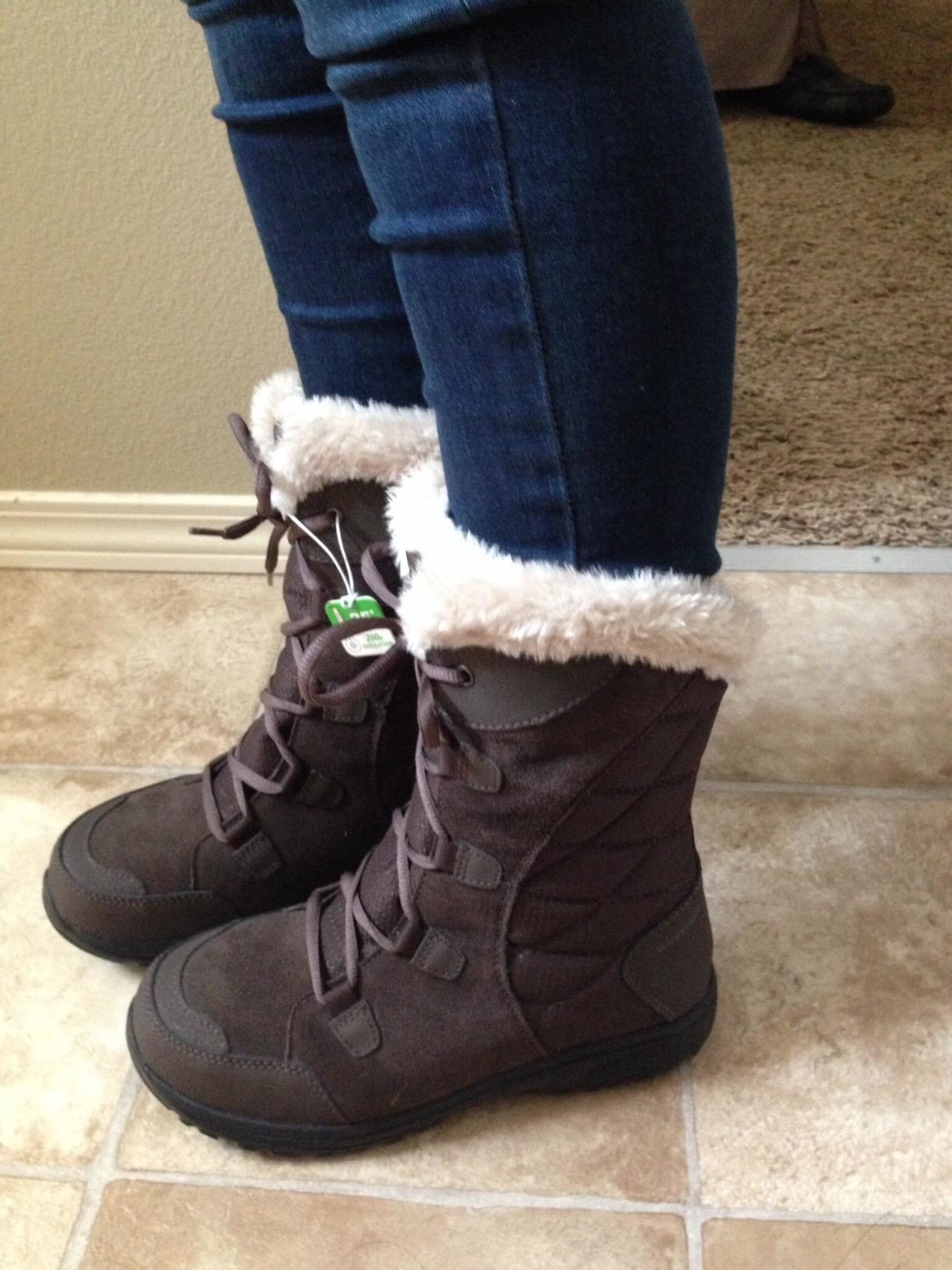 a reviewer in the boots in brown with faux fur at the tops