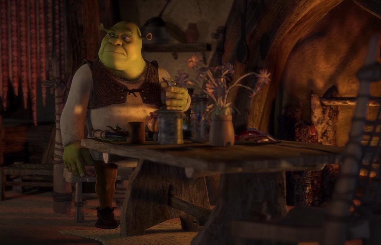 Shrek sitting alone at his table eating